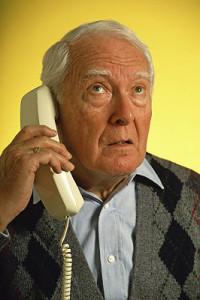 senior on a scam phone call