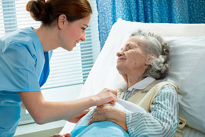 elderly woman recuperating with help from a home care aide