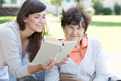 Aide Reading to Elderly Miami Woman