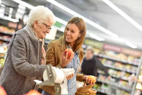aide helps senior shop